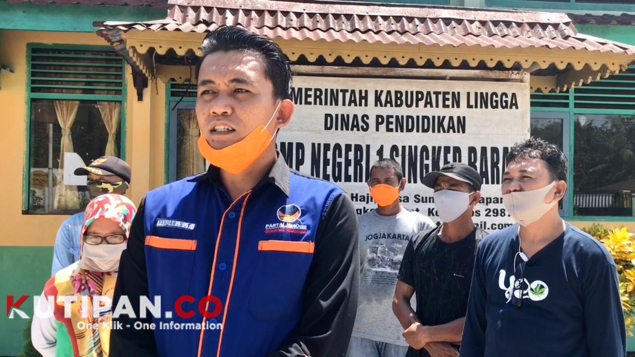 Foto Kader Nasdem, Nasdem Lingga, Nasdem semprot disinfektan di sekolah, Partai Nasdem